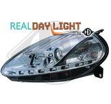 Fiat..DRL = day running light.  Strålkastare med parkeringsljus i slinga...Ett par designstrålkastare